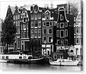 Homes Of Amsterdam Canvas Print by Leslie Leda