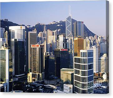 Hong Kong Skyline At Sunrise Canvas Print by Jeremy Woodhouse