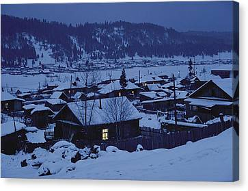 Houses In The Snow At Dusk Canvas Print by Dean Conger