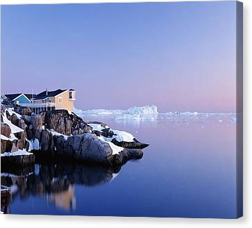 Houses On The Coastline With Icebergs Canvas Print by Axiom Photographic