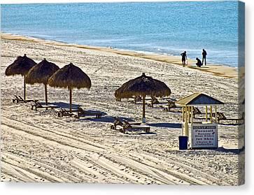 Huts On The Beach Canvas Print by Susan Leggett