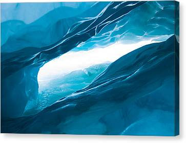Ice Cave On The Glacier Canvas Print by John White