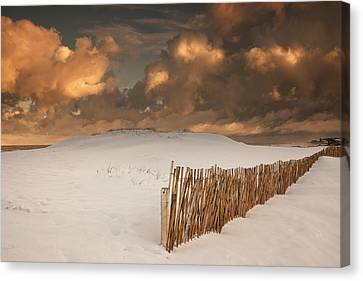 Illuminated Clouds Glowing Over A Snow Canvas Print by John Short