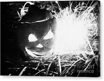 Illuminated Halloween Turnip Jack-o-lantern With Sparkler To Ward Off Evil Spirits Canvas Print by Joe Fox