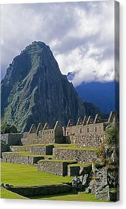 Inca Structures Stand Below Mount Canvas Print by Gordon Wiltsie