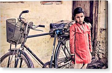 Indian Boy With Cycle Canvas Print by Parikshat sharma