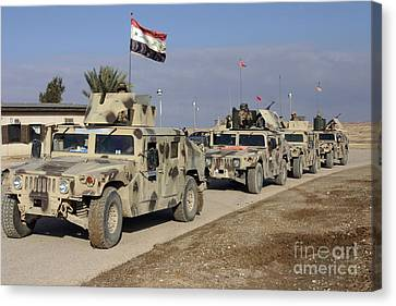 Iraqi Army Soldiers Aboard M1114 Humvee Canvas Print by Stocktrek Images