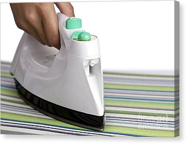 Ironing Canvas Print by Blink Images