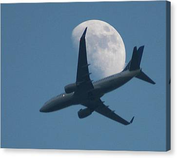 Jet In Front Of Moon Canvas Print by KM&G-Morris