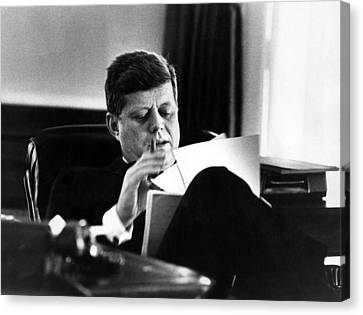 John F. Kennedy, In His Office Canvas Print by Everett