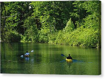 Kayakers Paddle In The Headwaters Canvas Print by Raymond Gehman