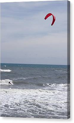 Kiteboarder With Kite In The Waves Canvas Print by Skip Brown
