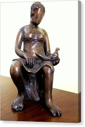Lady Bird Bronze Sculpture Of A Woman Sitting Holding A Bird With A Dress Face Blurred Strong Legs Canvas Print by Rachel Hershkovitz