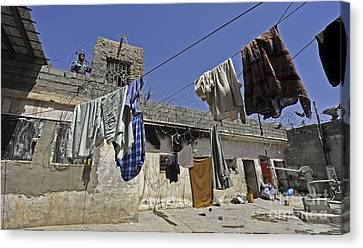 Laundry Hangs In The Courtyard Canvas Print by Stocktrek Images