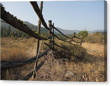 Leaning Fence  Canvas Print by Jeannine Welfelt