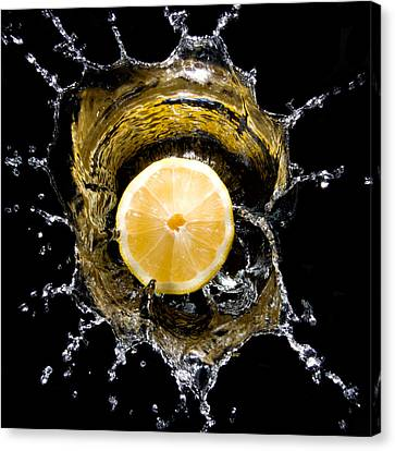 Lemon With Water Canvas Print by Cabriphoto.com
