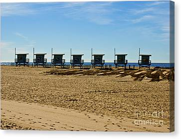 Lifeguard Stand's On The Beach Canvas Print by Micah May