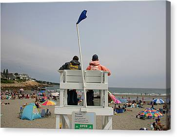 Lifeguards Watch Over The Traditional Canvas Print by Stephen St. John