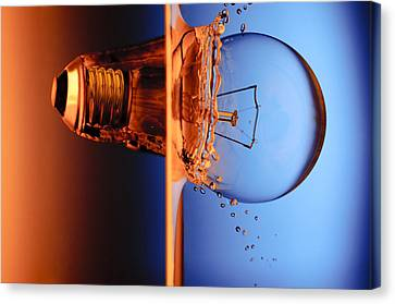 Light Bulb Shot Into Water Canvas Print by Setsiri Silapasuwanchai