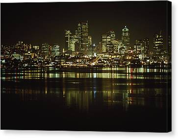 Lights Of Downtown Seattle Reflect Canvas Print by Gordon Wiltsie