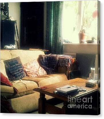 Sofa Canvas Print featuring the photograph Living Room by Isabella Abbie Shores