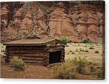 Log Cabin In The Desert Canvas Print by Dave Dilli