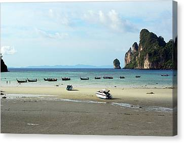 Long Tail Boats In Bay Of Phi Phi, Thailand Canvas Print by Thepurpledoor