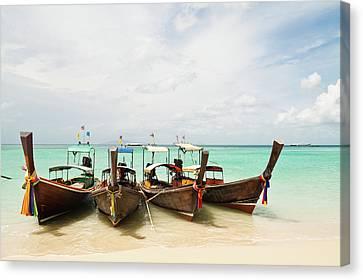 Longtail Boats At Phi Phi Island, Thailand Canvas Print by Melissa Tse