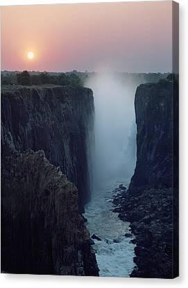 Looking Along Victoria Falls At Dusk Canvas Print by Axiom Photographic