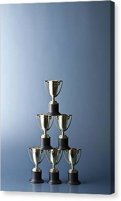 Loving Cup Trophies Stacked In A Pyramid Canvas Print by Larry Washburn