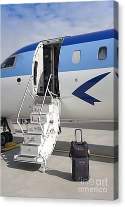 Luggage Near Airplane Steps Canvas Print by Jaak Nilson