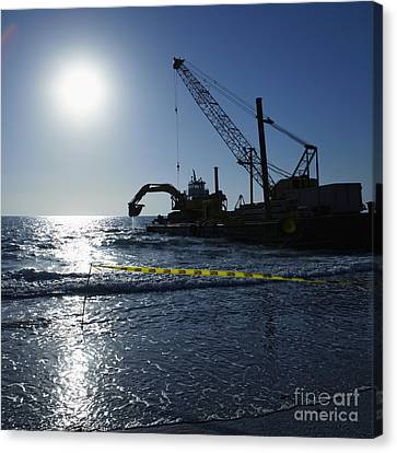 Machinery Cleaning Up A Pier Canvas Print by Skip Nall