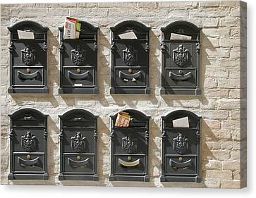 Mailboxes Lined On A Stone Wall Canvas Print by Gina Martin
