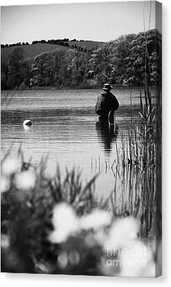 Man Flyfishing In A Lake In Ireland Canvas Print by Joe Fox