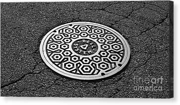Manhole Cover Canvas Print by Luke Moore