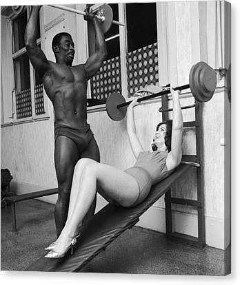 Matching Muscles Canvas Print by John Drysdale