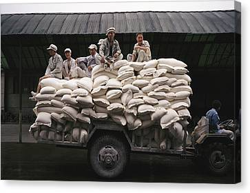 Men Sit On Bags Of Flour Canvas Print by Justin Guariglia