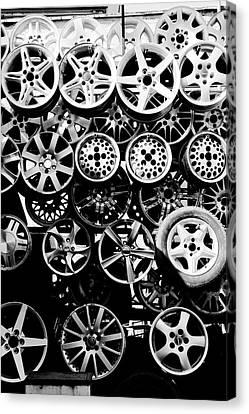Metal Wheels Canvas Print by Ion-Bogdan DUMITRESCU