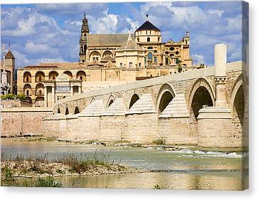 Mezquita Cathedral And Roman Bridge In Cordoba Canvas Print by Artur Bogacki