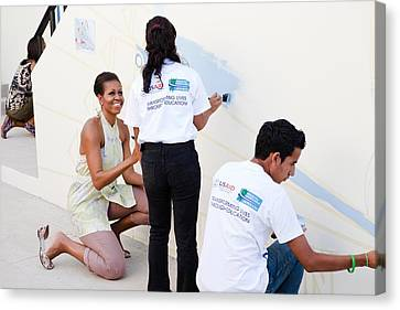 Michelle Obama Helps Paint A Mural Canvas Print by Everett