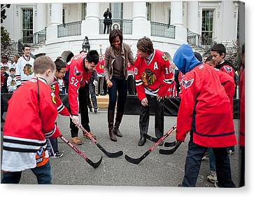 Michelle Obama Holds A Lets Move Canvas Print by Everett