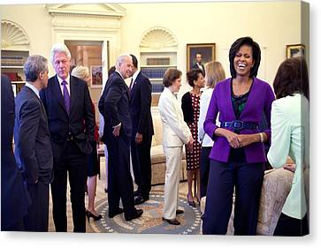 Michelle Obama Laughs With Guests Canvas Print by Everett