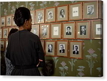 Michelle Obama Looks At Pictures Canvas Print by Everett