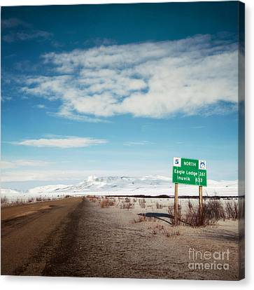 Milepost At The Dempster Highway Canvas Print by Priska Wettstein