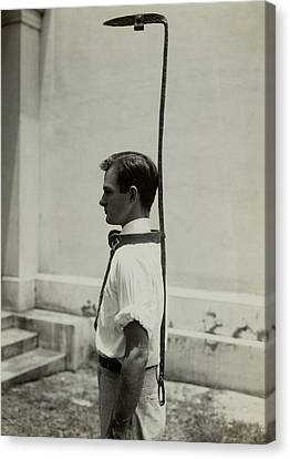 Model Wears A Slave Bell Rack, A Used Canvas Print by Everett