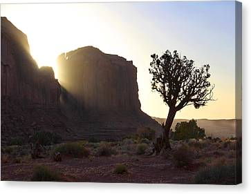Monument Valley At Sunset Canvas Print by Mike McGlothlen