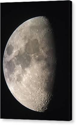 Moon Against The Black Sky Canvas Print by John Short
