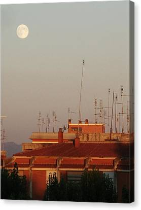 Moon Sight At Sunset Canvas Print by Luca Rosa