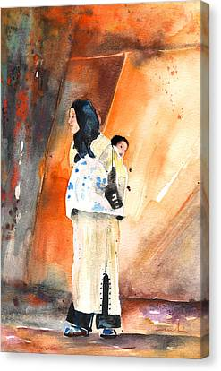 Moroccan Woman Carrying Baby Canvas Print by Miki De Goodaboom