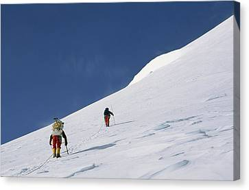Mountain Climbers Use Safety Ropes Canvas Print by Gordon Wiltsie